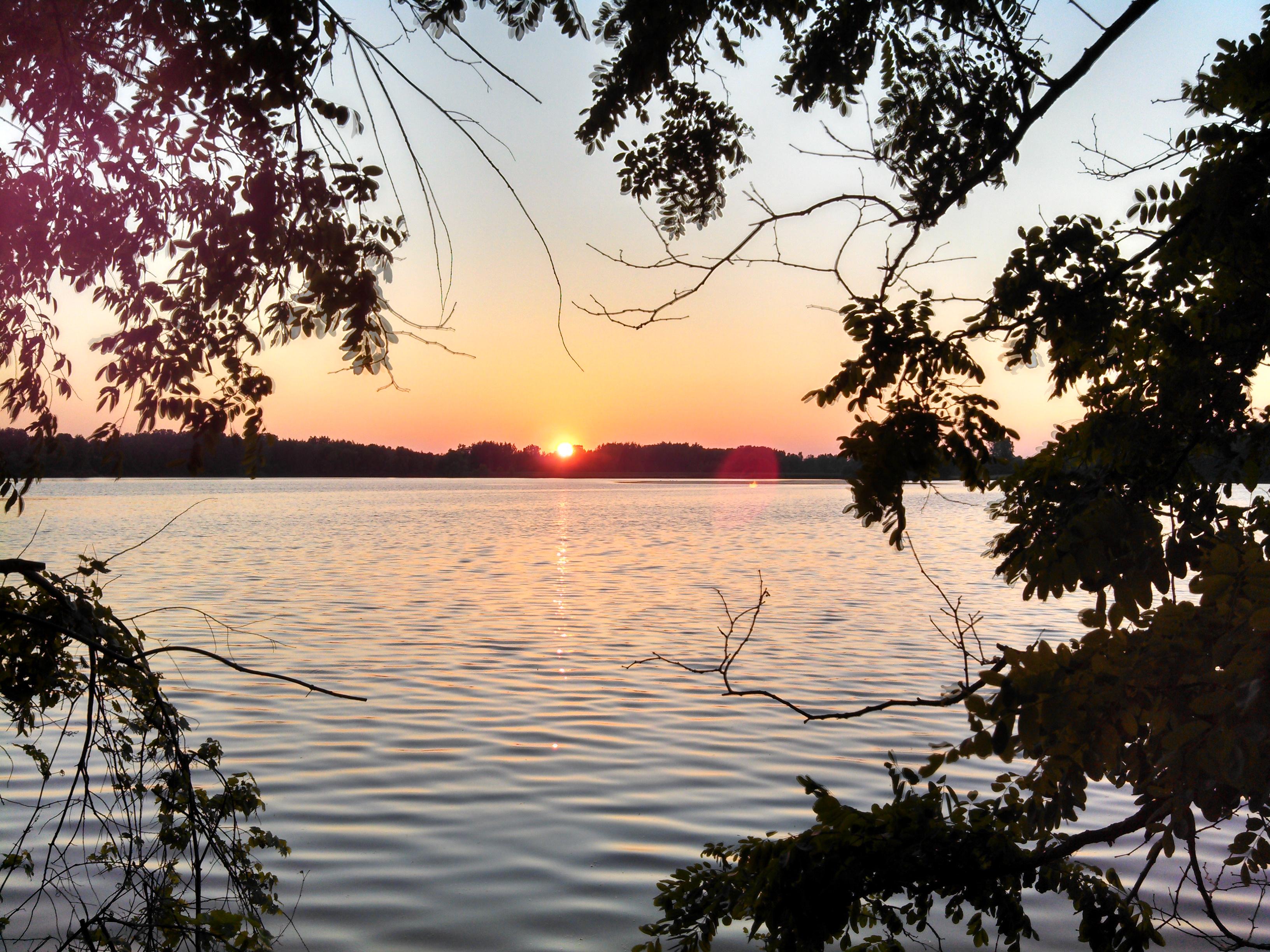 Sun on the Horizon Over Lake Ovid